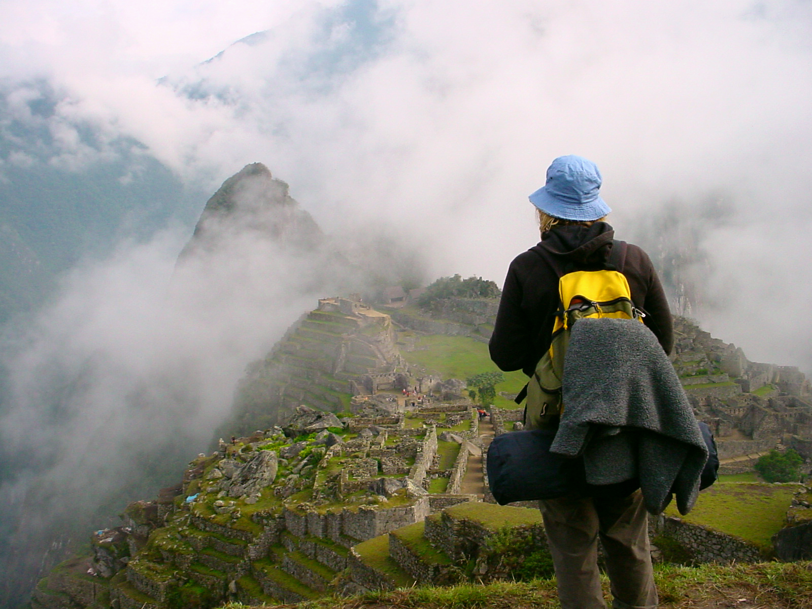 Woman overlooking at Machu Picchu