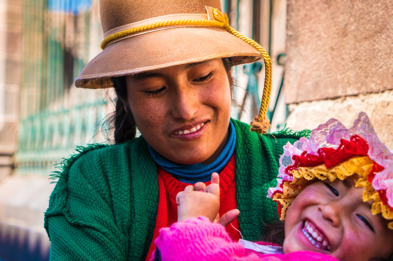 Peruvian Indigenous woman holding her child