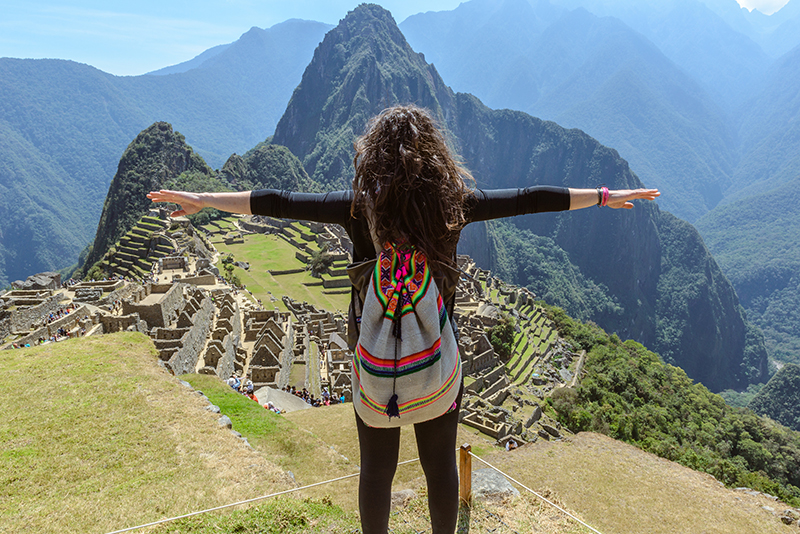 Woman standing at Machu Picchu